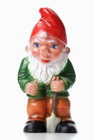 Garden Gnome houden spade Stockfoto