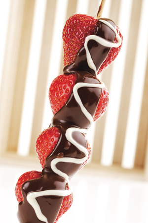 chocolate icing: Strawberry skewer with chocolate icing Stock Photo