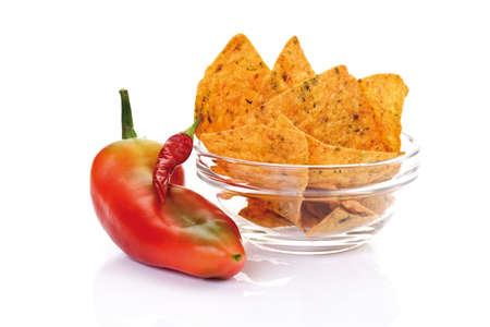 nacho: Bell pepper by bowl of nacho chips Stock Photo