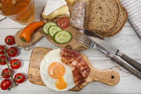 hearty: Hearty supper, fried egg and bacon on protein bread