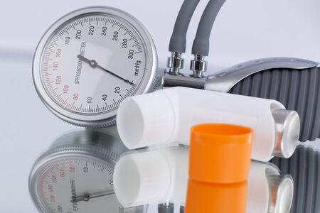 blood pressure gauge: Asthma spray and blood pressure gauge