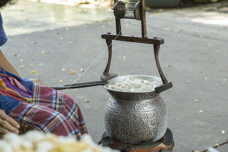 incidental people: Thailand, Bangkok, cooking cocoons for silk