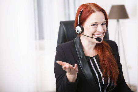 Young happy businesswoman with headset photo