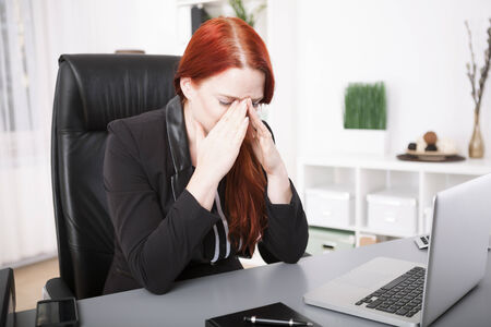 overstress: Young businesswoman exhausted on desk