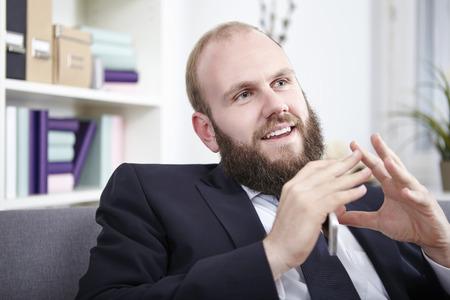 clarifying: Businessman explaining something, gesturing with hands Stock Photo