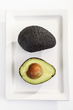 hass: Fresh Hass avocado on plate