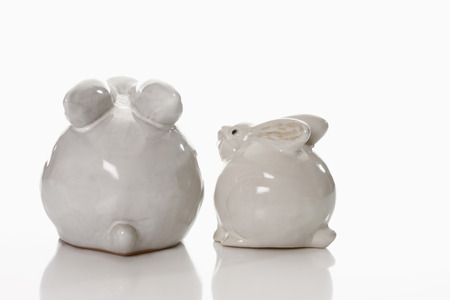figur: Two porcelain Easter bunny on white background