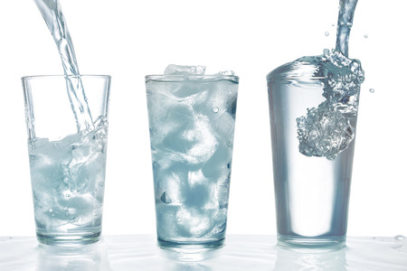 ice water: Drinking water being poured into glass with ice cubes
