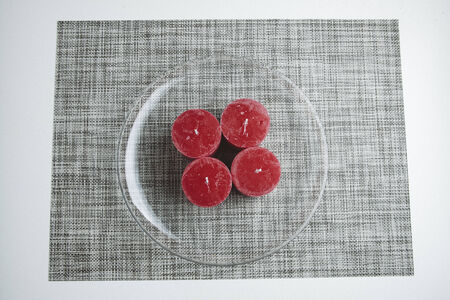 advent wreath: Minimalistic advent wreath, four candles on glass plate Stock Photo