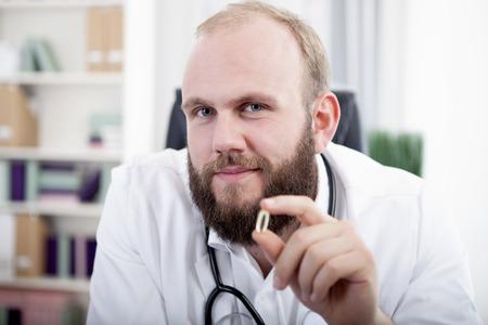 gel capsule: Doctor holding gel capsule Stock Photo