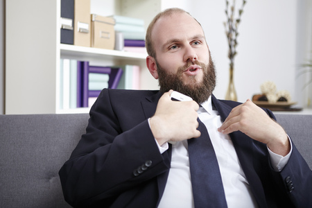clarifying: Businessman explaining something, gesturing with hands Stock Photo