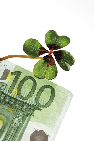 fourleafed: Four-leafed clover on 100 Euro banknote, close-up