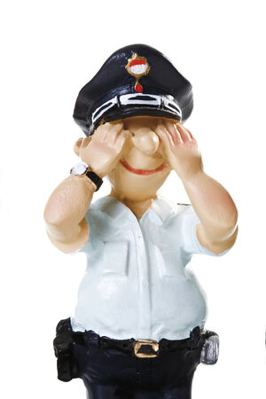 male likeness: Plastic Figurine of a Policeman, See no evil, close-up