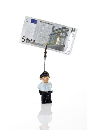 male likeness: Policeman figurine holding Euro note