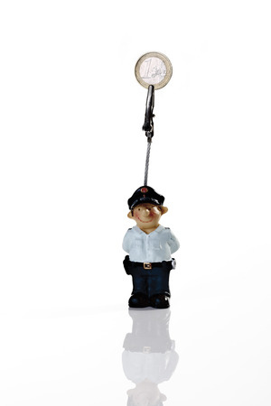 coined: Policeman figurine holding money