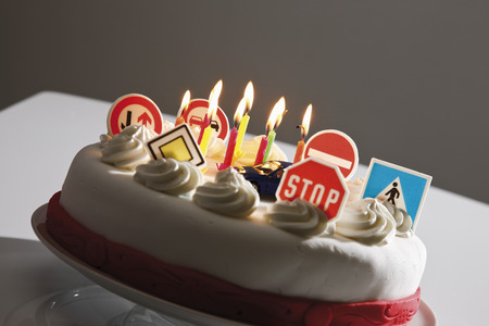 fondant fancy: Fancy cake with road signs and burning candles