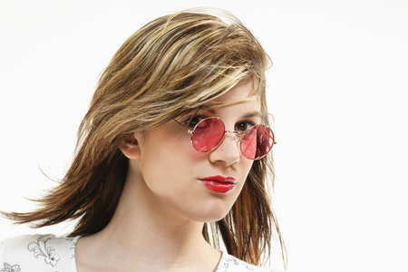 tinted glasses: Young woman with rose tinted glasses