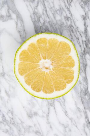 sweetie: Sweetie, grapefruit on gray marble