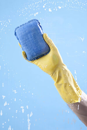 pane: Person cleaning glass pane Stock Photo