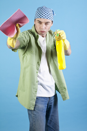 spray bottle: Man holding cleaning cloth and spray bottle, portrait