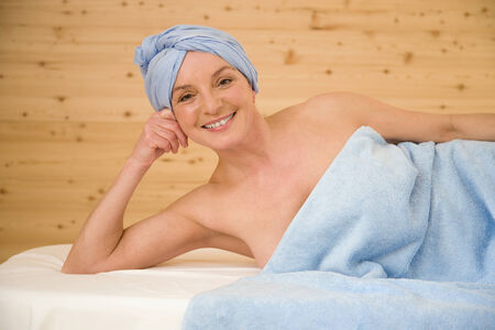 Mature womanan wrapped in a towel, portrait photo