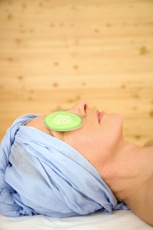 eye pad: Mature woman in a spa with eye pads on her eyes, portrait Stock Photo