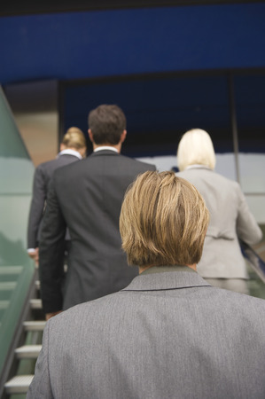 rear view: Germany, business people on stairs, rear view