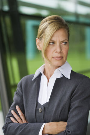 discontent: Germany, portrait of a businesswoman, arms  crossed