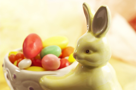 leporidae: Easter bunny figure with sugar easter eggs Stock Photo
