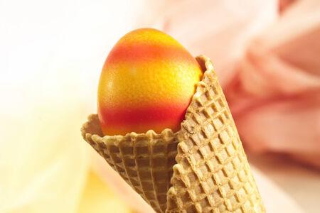 icecream cone: Ice-cream cone with colorful easter egg Stock Photo