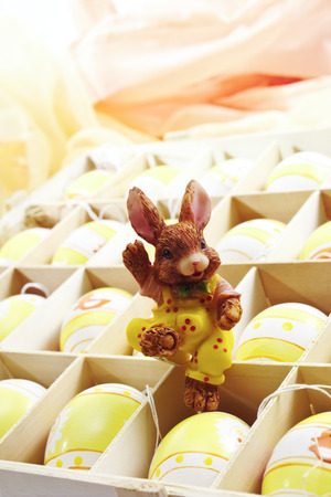 Gift box with easter eggs and easter bunny figure