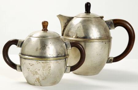 bronze bowl: Metal teapot and sugar bowl