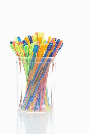 plastic container: Variety of cocktail sticks in plastic container Stock Photo