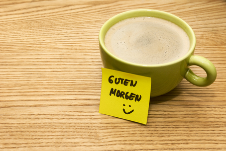 green smiley face: Cup of coffee, post-it note good morning and smiley