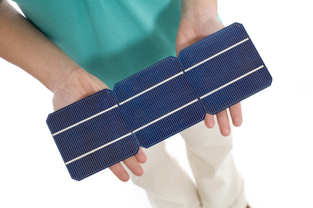 one person only: Woman holding solar cell