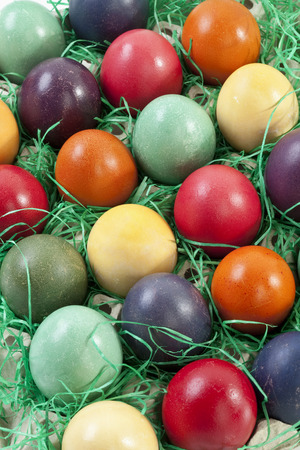 elevated view: Variety of Easter eggs in egg carton, elevated view Stock Photo