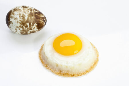 indulgence: Fried quail egg, close-up Stock Photo