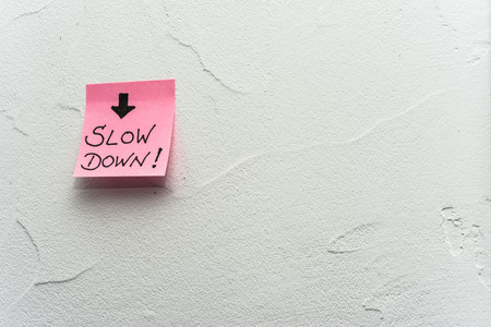 Wall, Post-it note slow down and arrow