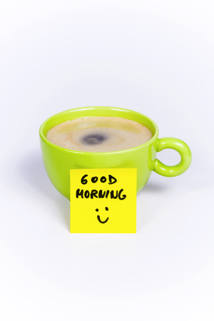 Green cup of coffee, organic coffee, sticky note good morning Standard-Bild