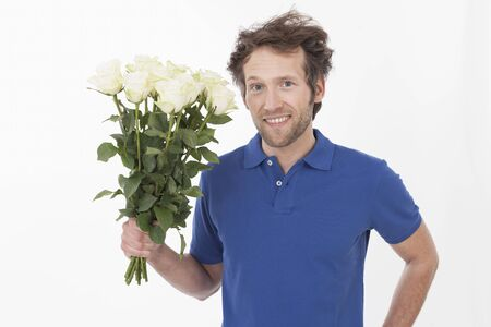 adult man with roses, smiling, portrait photo