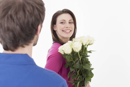 Woman holding roses, man in foreground photo