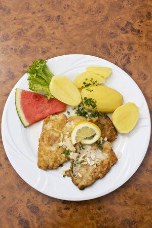 coalfish: Breaded coalfish fillet with boiled potatoes