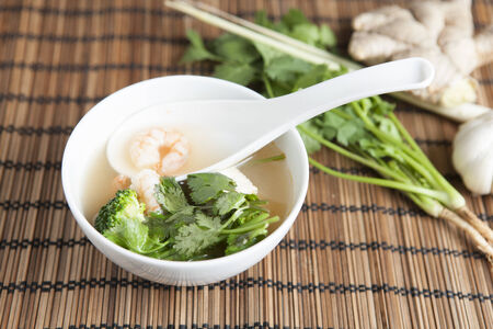 ingridients: Spicy Thai Tom Yam Soup, with ingridients in the background
