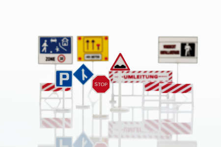 Variety of traffic signs on white background photo