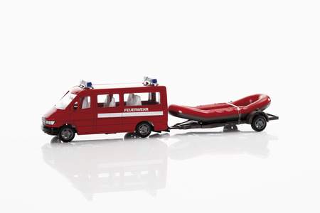 raft: Toy fire truck with rubber raft on white background