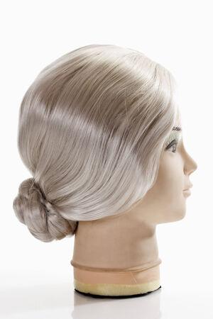 female likeness: Female mannequin head wearing grey wig on white background