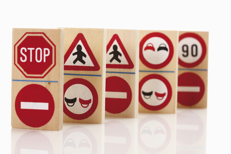 western script: Domino with traffic signs on white background
