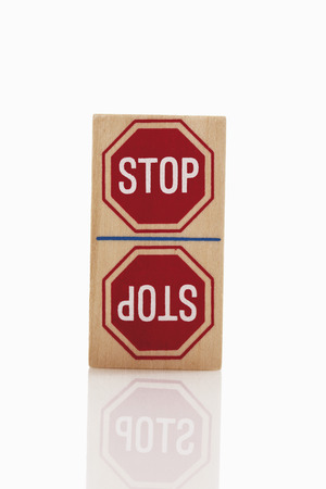 western script: Domino with stop sign on white background