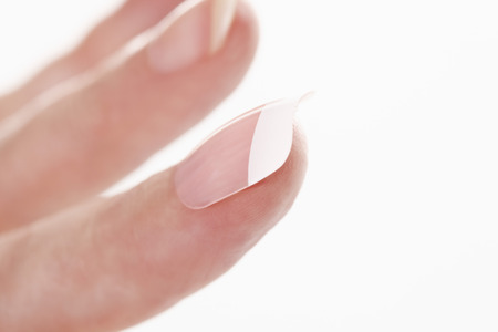 conceit: Human fingers with artifical nails Stock Photo