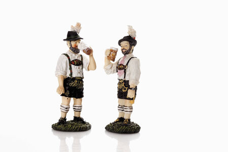 male likeness: Bavarian figurines drinking beer from beer stein